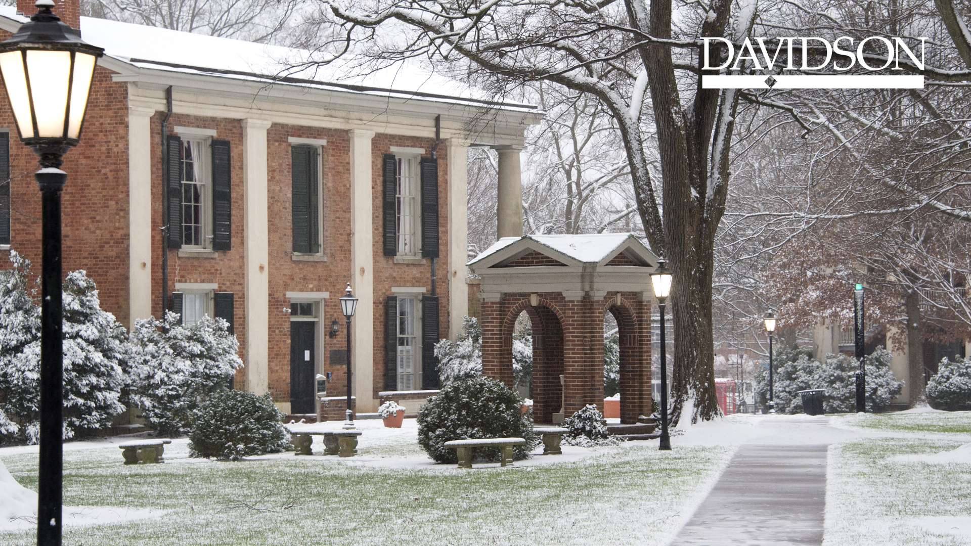 Historic campus with snow and Davidson logo